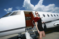 Woman exiting private jet