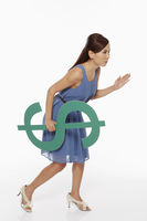 Woman holding a dollar sign