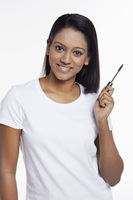 Woman holding a mascara brush