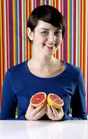 Woman holding blood oranges