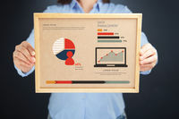 Popular : Woman holding board with data management concept and infographics