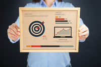 Popular : Woman holding board with target marketing concept and infographics
