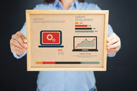 Popular : Woman holding board with website development concept and infographics