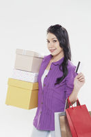 Woman holding credit card and shopping items