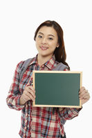Woman holding up a blackboard