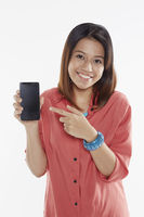 Woman holding up mobile phone