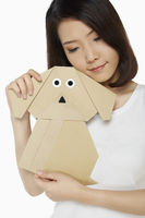 Woman hugging a paper dog