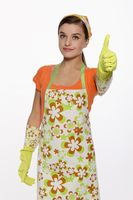 Woman in apron showing thumbs up