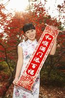 Woman in cheongsam holding banner