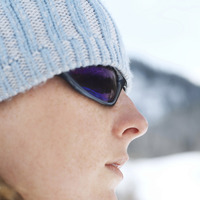 Woman in knitted hat and sunglasses