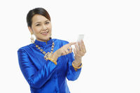 Woman in traditional clothing using a mobile phone