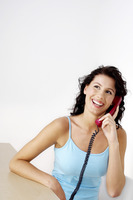 Woman laughing while talking on the phone