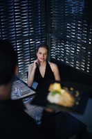 Woman looking at her meal being served by waiter
