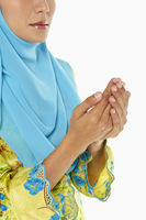 Woman praying with palms placed together
