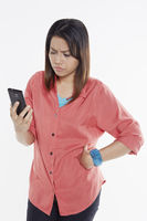 Woman reading text message angrily