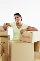 Woman sitting amongst cardboard boxes