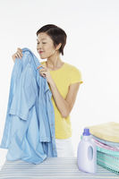Woman smelling a clean blouse
