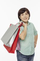 Woman smiling and carrying shopping bags