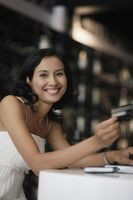 Woman smiling while holding credit card