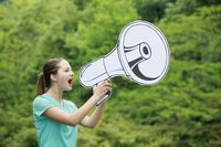 Woman speaking through megaphone