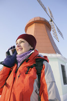Woman talking on the phone, windmill in the background