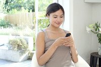 Woman text messaging on the mobile phone