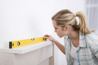 Woman using spirit level