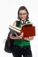 Woman with backpack reading book