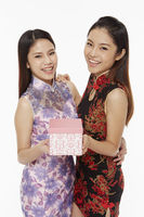 Women holding a gift box
