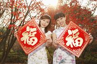 Women holding chinese new year decorative item