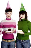 Women in party hats holding cakes