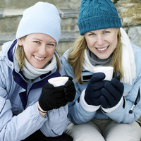 Women in warm clothing enjoying hot drinks