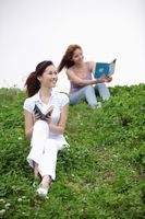 Women reading outdoors
