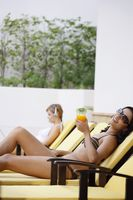 Women relaxing by the pool side
