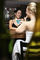 Women talking and laughing in a bar