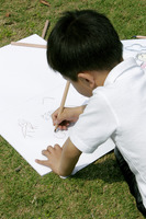 Young boy painting picture in the park