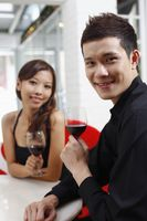 Young couple enjoying wine