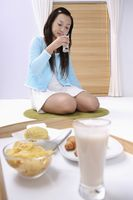 Young woman enjoying a glass of milk
