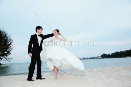 Celebration : Bride and groom dancing on the beach