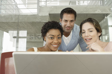 Business : Business colleagues using laptop in office