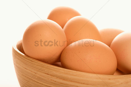 Background : Close - up of eggs in bowl