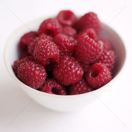Background : Close up of some raspberries in a bowl