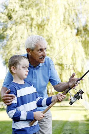 Park Outdoor : Grandfather and grandson fishing together