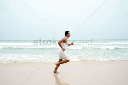 Water : Man jogging on the beach