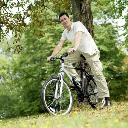 Park Outdoor : Man sitting on the bicycle
