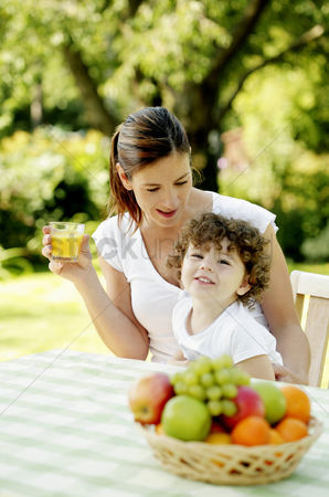 Park Outdoor : Mother and daughter sitting at the picnic table