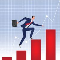 Businessman climbing the bar graph