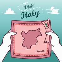Hands holding trento paper map