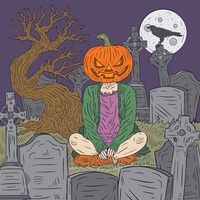 Pumpkin person in graveyard
