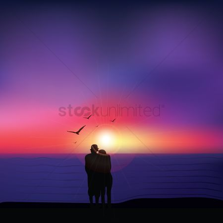 Shine : Couple seeing sunset at beach